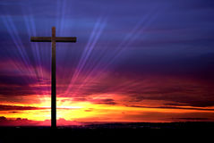 Christian cross on red sunset background Royalty Free Stock Photography