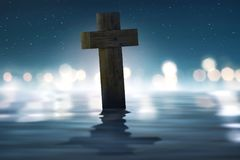 Christian cross in river with blurred light. At night royalty free stock images