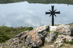 Christian cross on rocky hill Stock Photography