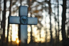 Christian cross and setting sun abstraction. Blured and defocussed christian abstraction stock photography