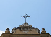 Christian cross sign on top of historical church Royalty Free Stock Image