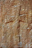 Christian cross in the stone work of a chapel wall Royalty Free Stock Image