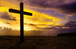 Christian cross on sunset. Background Royalty Free Stock Image