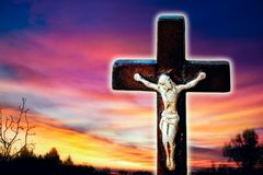 Religious christian cross with sunset sky . Christian cross on sunset background . Way to God . bright light from heaven . Religious background stock photo