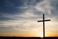 A christian cross at sunset. With nobody in shot Royalty Free Stock Image
