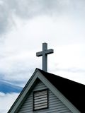 Christian cross on top of a church roof Royalty Free Stock Photos