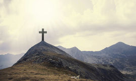 Christian cross on top of the hill with sunrays, crucifixion, re Royalty Free Stock Image
