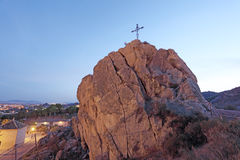 Christian cross on top of a rock in Lorca Stock Photo