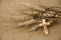 Christian Cross And Wheat. Christian cross on wheat ears - religious concept Royalty Free Stock Photo