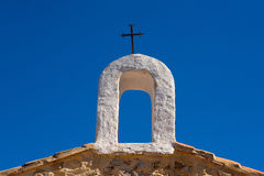 Christian cross on whitewashed arch at village church Stock Images