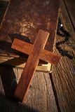 Christian cross on wood bible and rosary. Beads over wooden vintage background royalty free stock photo