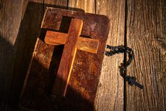 Christian cross on wood bible and rosary. Beads over wooden vintage background royalty free stock photos