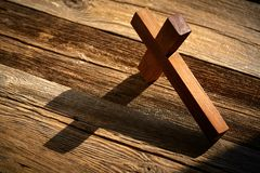 Christian cross on wood over wooden. Background vintage with shadows stock photography