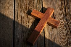 Christian cross on wood over wooden. Background vintage with shadows royalty free stock photography