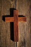 Christian cross on wood over wooden. Background vintage with shadows royalty free stock photos