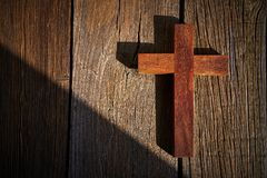 Christian cross on wood over wooden. Background vintage with shadows stock photos