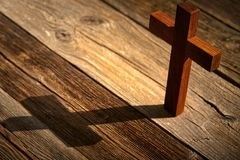 Christian cross on wood over wooden. Background vintage with shadows royalty free stock image
