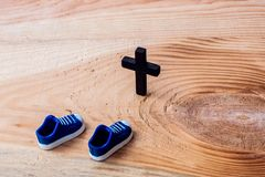Christian cross on wood over wooden background vintage with shadows stock photography