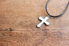 Christian cross on wooden table with window light. Christian concept Jesus is the light of the world, Copy space for design Royalty Free Stock Photos