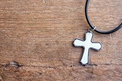 Christian cross on wooden table with window light. Christian concept Jesus is the light of the world, Copy space for design royalty free stock photo