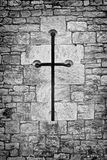 Christian crucifix or cross in the stone work of a chapel wall Royalty Free Stock Image