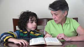 Daily Christian Devotional: Family reading the Bible stock video
