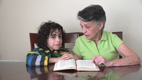 Daily Christian Devotional: Family reading the Bible stock video footage