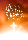 Christian easter scene, Saviour`s cross on dramatic orange sky, with text He is risen, illustration Royalty Free Stock Photo