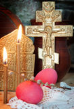 Christian Easter still life with red eggs and metal cross Stock Photography