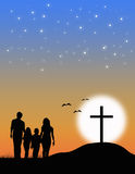 Christian family at the Cross. Aduring the sunset Stock Photos