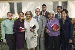 Christian Family on patio holding Bibles portrait Royalty Free Stock Photo
