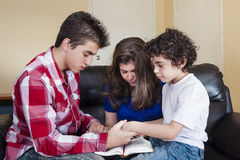 Christian Family Praying. Christian family pray in their daily devotional at home stock photo