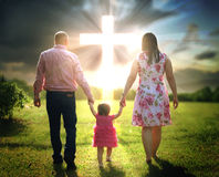 Christian family walks to cross Stock Image