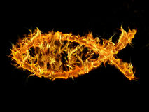 Christian Fish on Fire. Christian fish symbol on fire with black background Stock Photo