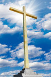 Christian gold cross on sky. Religion and faith concept. Stock Photo