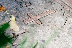 Christian Grave Marker in Cemetery Stock Photo