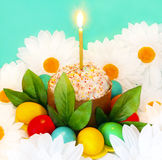 Christian holiday of Easter. The symbol of a great Christian holiday of Easter kulich with dyed eggs and a candle royalty free stock images