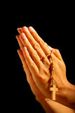 Christian human praying. With rosary in hands royalty free stock photos