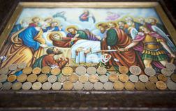 Christian icon and coins Stock Photos