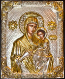 Christian icon-detail. Vergin Mary with child Jesus.icon made of silver partially gilded Royalty Free Stock Photo