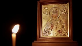 Christian Icon van Heilige Nicholas And Burning Candle stock video