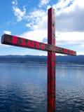 Christian iron cross on sea coast Stock Photo