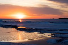 Christian Island Sunset - Georgian Bay in Winter. Winter sunset on Georgian Bay near Christian Island in late February as the ice begins to break up and weary stock images
