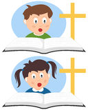 Christian Kids Reading a Book. Two Christian kids reading a book and learning. Eps file available Royalty Free Stock Photo