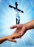 Christian love. Father and child in loving protecting gesture over divine rays of light and cross with Jesus Christ stock photo