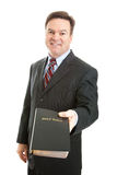 Christian Man with Bible. Christian businessman, minister, or missionary, holding a bible. Isolated on white stock photos