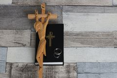Christian marriage. Christian prayer book, crucifix and marriage rings Royalty Free Stock Photography