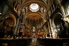 Christian mass. At ancient catholic cathedral. Divine ray drops at parishioner Stock Images