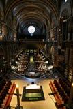 Christian mass. At ancient catholic cathedral. Divine ray drops at parishioner Stock Photos