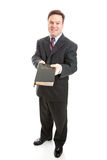 Christian Missionary or Bible Salesman. Christian businessman or Bible salesman spreading the word of God. Full body isolated on white royalty free stock images